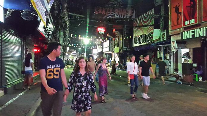 Walking Street went dark as people solemnly observed the 2nd anniversary of the passing of the late King Bhumibol Adulyadej.