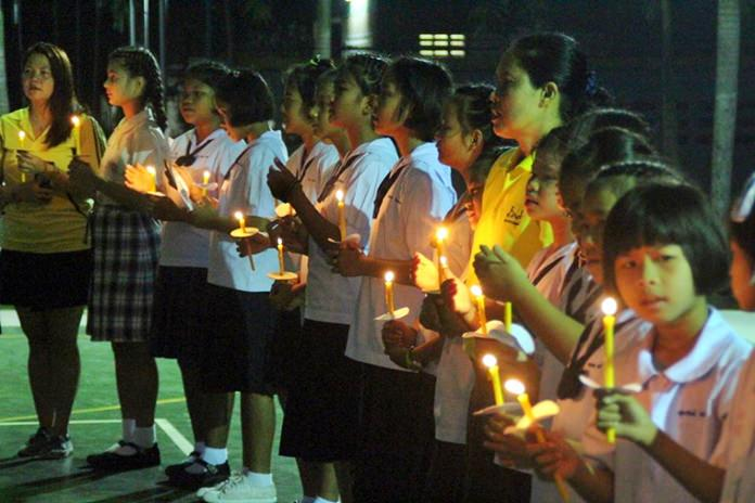 Children from the Child Protection and Development Center lovingly take part in the candlelight ceremony.