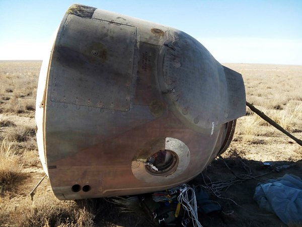 In this photo provided by Russian Defense Ministry Press Service, the Soyuz MS-10 space capsule lays in a field after an emergency landing near Dzhezkazgan, about 450 kilometers (280 miles) northeast of Baikonur, Kazakhstan, Thursday, Oct. 11, 2018. (Russian Defense Ministry Press Service photo via AP)