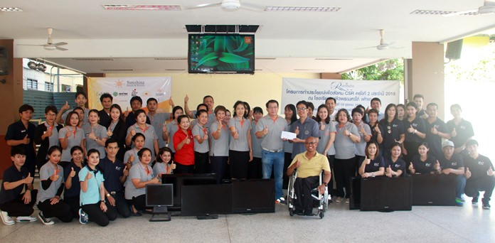 The Sunshine hotels group Executive Director Thana Supornsahatrangsi presents a donation of 23,900 baht and damaged electronics and appliances for vocational students to use in their studies at the Redemptorist Vocational School for Persons with Disabilities.