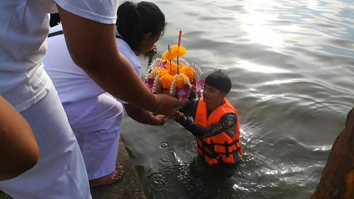 Participants float krathongs carrying incense and candles as well as paper wishes and fake money.