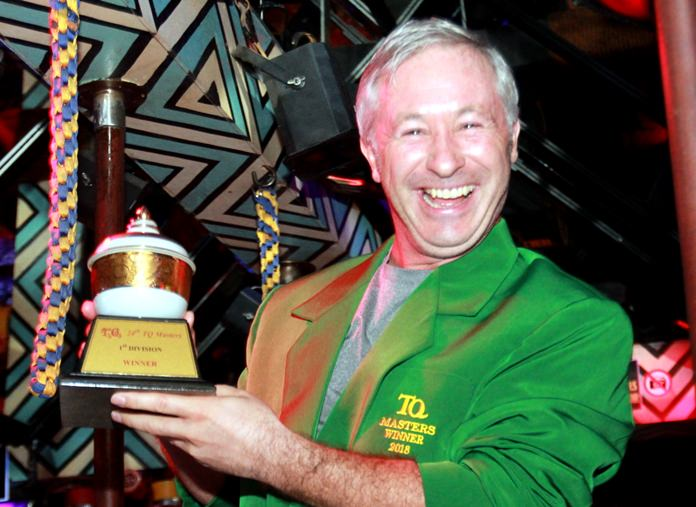 Richard Anderson wears the Green Jacket and holds his trophy after winning the 23rd annual T.Q. Masters golf classic.