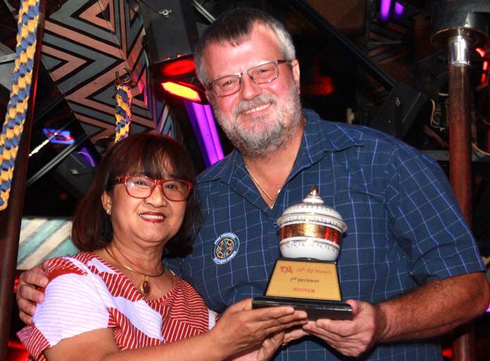 B Flight winner Daniel Tobler accepts his trophy from Mama-san Ead.
