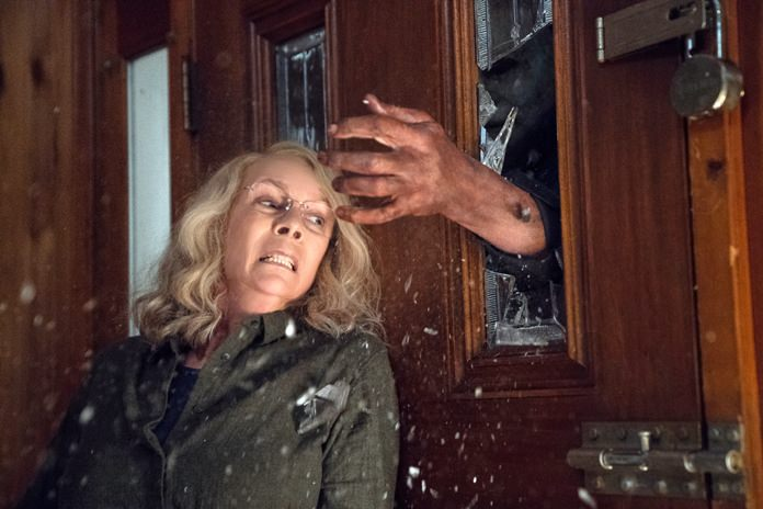 "This image released by Universal Pictures shows Jamie Lee Curtis in a scene from ""Halloween"". (Ryan Green/Universal Pictures via AP)"