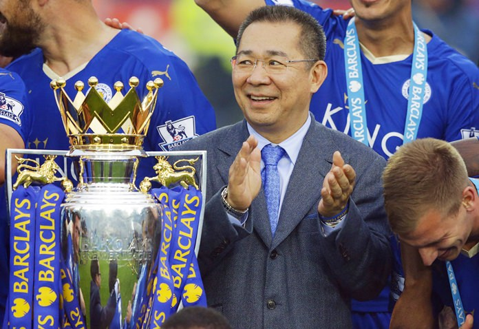 In this May 7, 2016, file photo, Vichai Srivaddhanaprabha applauds beside the trophy as Leicester City celebrate becoming the English Premier League soccer champions at King Power stadium in Leicester, England. (AP Photo/Matt Dunham, File)