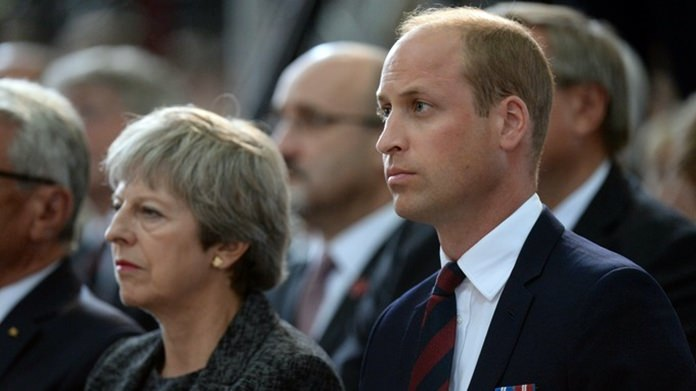 UK Prime Minister Theresa May and Prince William pay tribute to the Leicester crash victims (Credit: PA images)