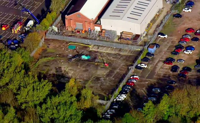 In this image made from video provided by Sky News, the site of a helicopter crash is seen near a carpark by the King Power stadium in Leicester, England, Sunday, Oct. 28, 2018. (Sky News via AP)