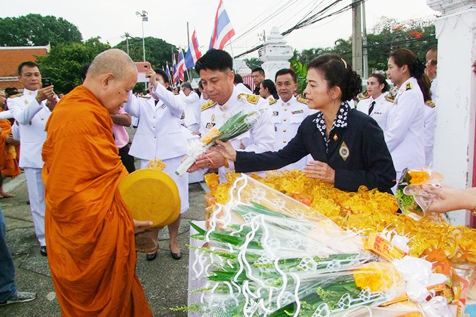 Chonburi Gov. Pakarathorn Thienchai leads the alms giving ceremony at the provincial hall.