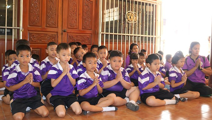 Students of Ban Nongprue School participate in morning activities during Auk Pansaa at Wat Nongprue.