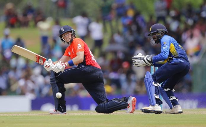 England's Joe Root plays a shot as Sri Lanka's wicketkeeper Niroshan Dickwella watches during the second one-day international cricket match in Dambulla, Sri Lanka, Saturday, Oct. 13. (AP Photo/Eranga Jayawardena)