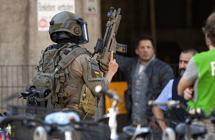 Special police operate outside the Cologne train station in Germany, Monday, Oct. 15. (Marius Becker/dpa via AP)