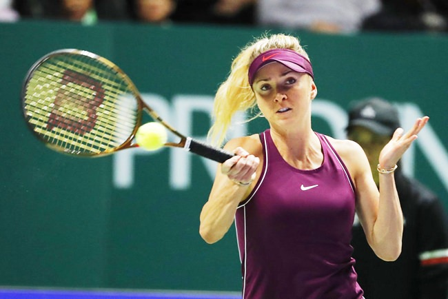 Elina Svitolina of the Ukraine plays a return shot while competing against Sloane Stephens of the United States during their women's singles match at the WTA tennis finals in Singapore, Sunday, Oct. 28. (AP Photo/Vincent Thian)