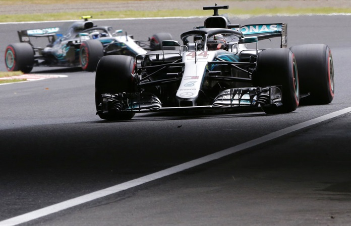 Mercedes driver Lewis Hamilton of Britain steers his car chased by his teammate Mercedes driver Valtteri Bottas of Finland during the third practice session for the Japanese Formula One Grand Prix at the Suzuka Circuit in Suzuka, central Japan, Saturday, Oct. 6. (AP Photo/Toru Takahashi)