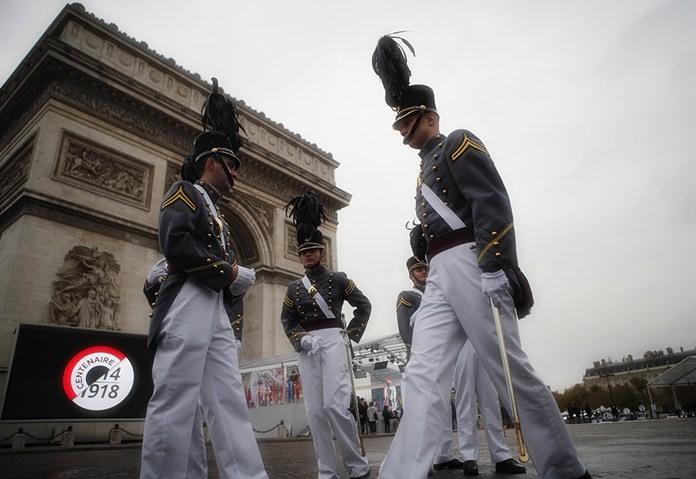 Cadets form the New York military academy wait near the Arc de Triomphe Sunday, Nov. 11, 2018 in Paris. (AP Photo/Francois Mori, Pool)
