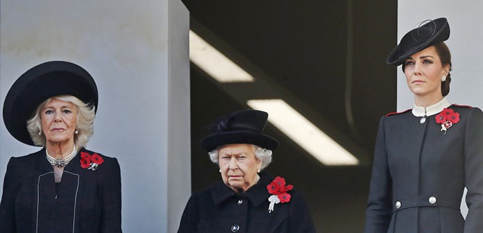 Britain's Queen Elizabeth II, center, Camilla, Duchess of Cornwall, and Kate, Duchess of Cambridge, right, attend the Remembrance Sunday ceremony at the Cenotaph in London, Sunday, Nov. 11, 2018. (AP Photo/Alastair Grant)