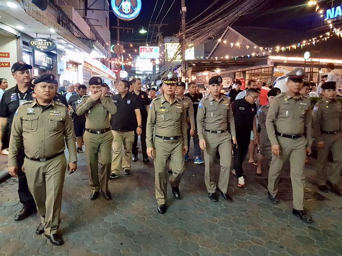 Pol. Maj. Gen. Teerapol Kubtanon leads officers and volunteers down Walking Street to ensure safety measures are in place.
