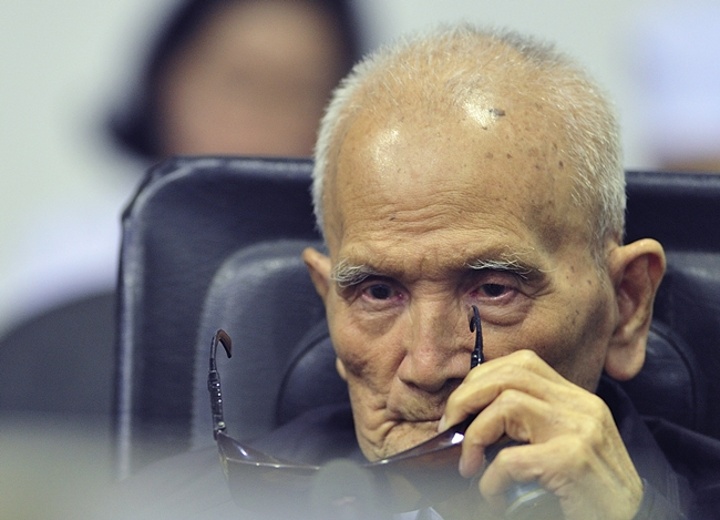 Nuon Chea, who was the Khmer Rouge's chief ideologist and No. 2 leader, sits in a court room before a hearing at the U.N.-backed war crimes tribunal in Phnom Penh, Cambodia, Friday, Nov. 16, 2018. (Mark Peters/Extraordinary Chambers in the Courts of Cambodia via AP)