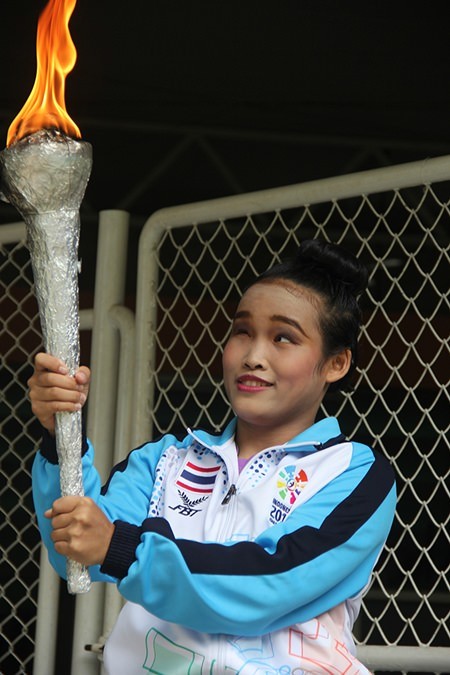 Carrying the flame to open the games.
