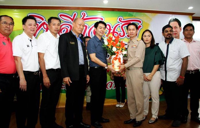 Deputy Mayors Poramet Ngampichet and Banlue Kullavanijaya led a delegation to the district office to congratulate Amnart Charoensri as Banglamung District's new chief, and his wife Jarunee.