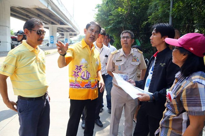 Deputy Mayor Pattana Boonsawat brought city workers to the area below the Bali Hai flyover as the city prepares to tackle chronic flooding there.