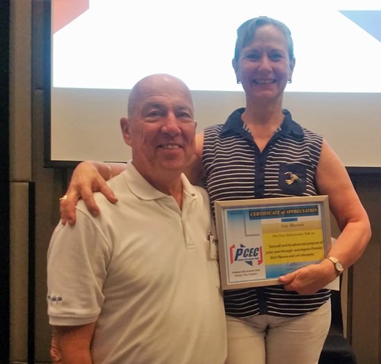 MC Roy Albiston presents Gay Burnett with the PCEC's Certificate of Appreciation for her presentation on back pain including how to avoid it and what to do if you have it.