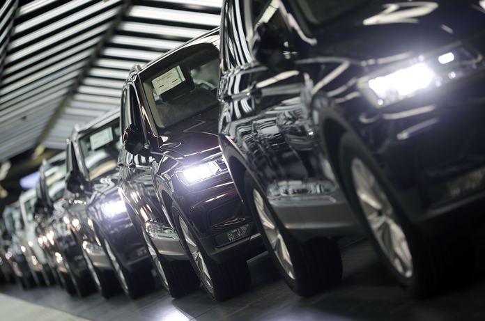 In this March 8, 2018 file photo, Volkswagen cars are pictured during a final quality control at the Volkswagen plant in Wolfsburg, Germany. (AP Photo/Michael Sohn)