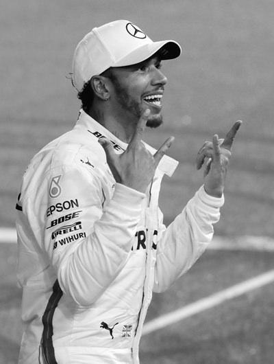 Mercedes driver Lewis Hamilton of Britain celebrates his victory after the Emirates Formula One Grand Prix at the Yas Marina racetrack in Abu Dhabi, United Arab Emirates, Sunday, Nov. 25. (AP Photo/Luca Bruno)