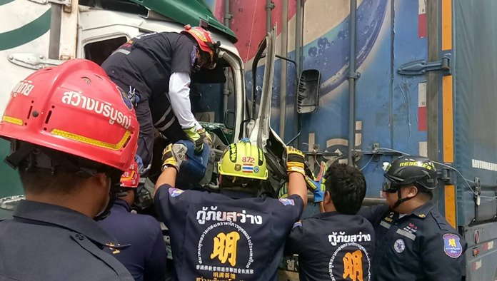 Rescue workers need to cut Uthai Polun out of the cab of his truck after he slammed into the back of a larger truck in Pong. He died later at Banglamung Hospital.