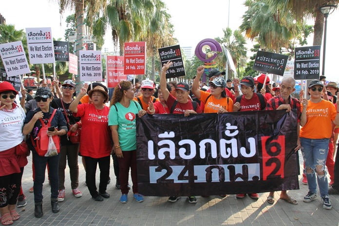 """Pattaya-based """"red shirt"""" pro-democracy activists rallied at Central Festival Pattaya Beach, calling for the government to guarantee new elections will be held as promised on Feb. 24."""
