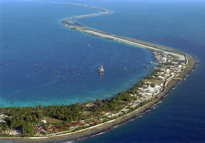 This July 27, 1995 file photo shows the Mururoa Atoll bases, 750 miles southeast of Tahiti, French Polynesia in the Pacific Ocean. (AP Photo/Francois Mori)