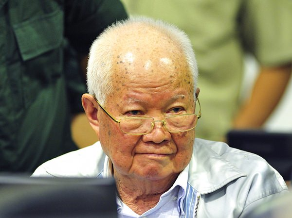 Khieu Samphan, former Khmer Rouge head of state, sits in a court room before a hearing at the U.N.-backed war crimes tribunal in Phnom Penh, Cambodia, Friday, Nov. 16. (Mark Peters/Extraordinary Chambers in the Courts of Cambodia via AP)