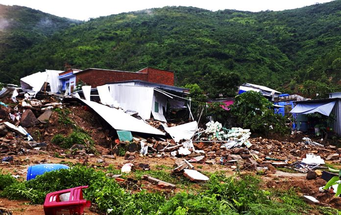 This Sunday, Nov. 18, 2018, photo shows several houses damaged by landslides in south-central resort city of Nha Trang, Vietnam. (Phan Thi Sau/Vietnam News Agency via AP)
