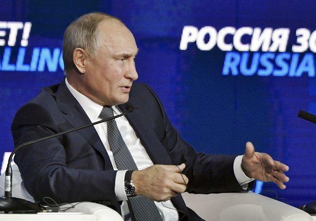 "Russian President Vladimir Putin speaks at an annual VTB Capital ""Russia Calling!"" Investment Forum in Moscow, Russia, Wednesday, Nov. 28. (Alexei Nikolsky, Sputnik, Kremlin Pool Photo via AP)"