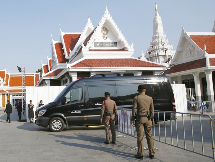 A hearse carrying the body of Thai billionaire and Leicester City owner Vichai Srivaddhanaprabha arrives at Debsirindrawas Temple in Bangkok, Friday, Nov. 2, 2018. (AP Photo/Sakchai Lalit)