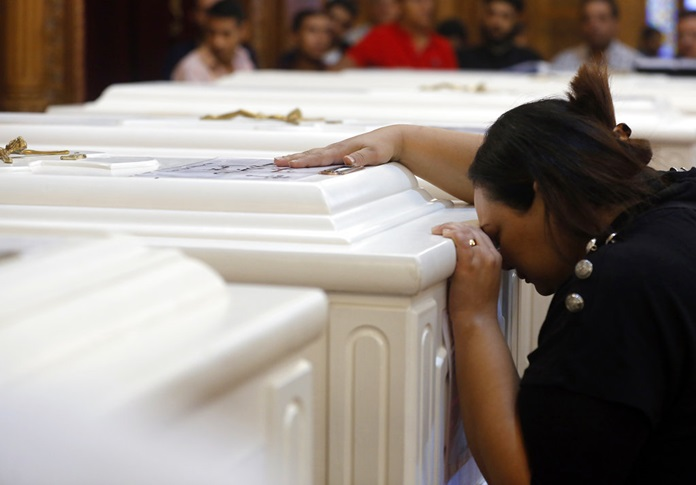 A relative of a slain Christian grieves during funeral service at Church of Great Martyr Prince Tadros, in Minya, Egypt, Saturday, Nov. 3. (AP Photo/Amr Nabil)