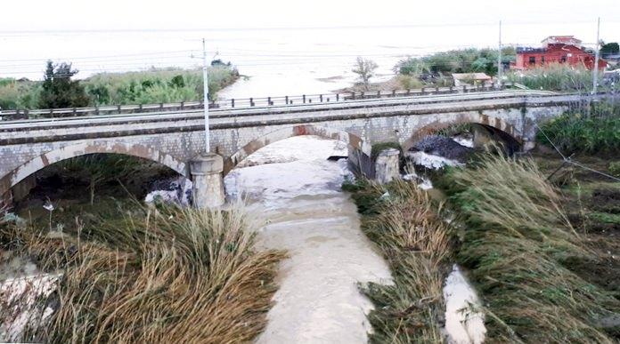 The swollen Milicia river runs in the area where nine people lost their lives when their home was flooded in Casteldaccia, near Palermo, Sicily, Sunday, Nov. 4. (Ruggero Farkas/ANSA via AP)
