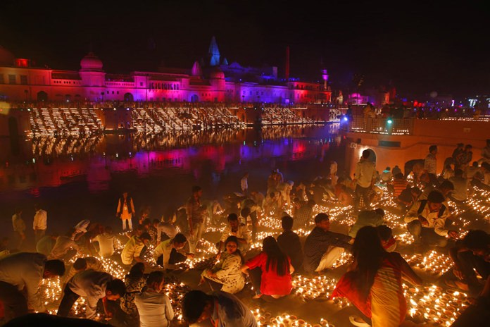 Devotees light earthen lamps on the banks of the River Sarayu as part of Diwali celebrations in Ayodhya, India, Tuesday, Nov. 6. (AP Photo/Rajesh Kumar Singh)