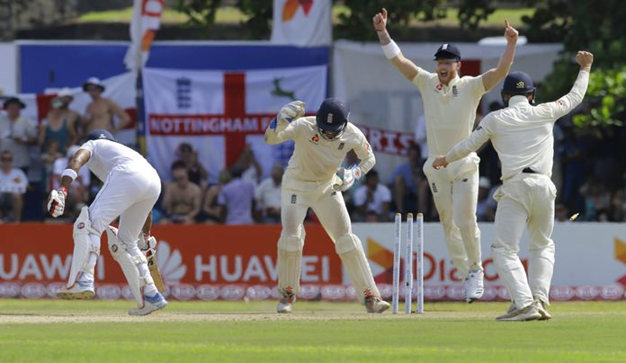 England's wicketkeeper Ben Foakes, second left, successfully stumps Sri Lanka's Dinesh Chandimal, left, during the second day of the first test cricket match between Sri Lanka and England in Galle, Sri Lanka, Wednesday, Nov. 7. (AP Photo/Eranga Jayawardena)