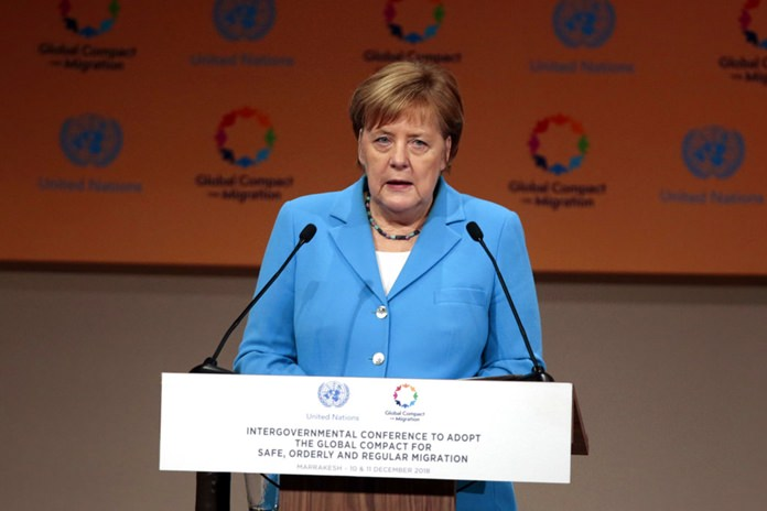 German Chancellor Angela Merkel addresses delegates during the opening session of a UN Migration Conference in Marrakech, Morocco, Monday, Dec.10. (AP Photo/Mosa'ab Elshamy)
