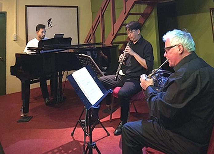 (From left) Hazim Suhadi (piano), Cooper Wright (oboe), and Bob Stoel (horn) of the Bandung Trio perform at Ben's Theatre in Jomtien.