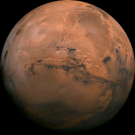 This image made available by NASA shows the planet Mars. This composite photo was created from over 100 images of Mars taken by Viking Orbiters in the 1970s. In our solar system family, Mars is Earth's next-of-kin, the next-door relative that has captivated humans for millennia. (NASA via AP, File)