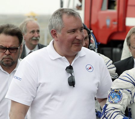 Roscosmos state space corporation head Dmitry Rogozin said in a video posted to Twitter on Saturday, Nov. 24, 2018, that a proposed Russian mission to the moon will be tasked with verifying that the American moon landings were real, though he appeared to be making a joke. (AP Photo/Dmitri Lovetsky, Pool Photo via AP, File)