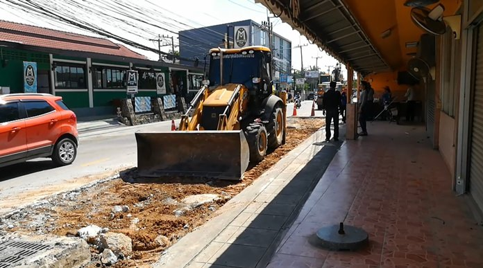 Nongprue public works crews repair a section of Soi Khao Soi that had subsided due to repeated flooding.