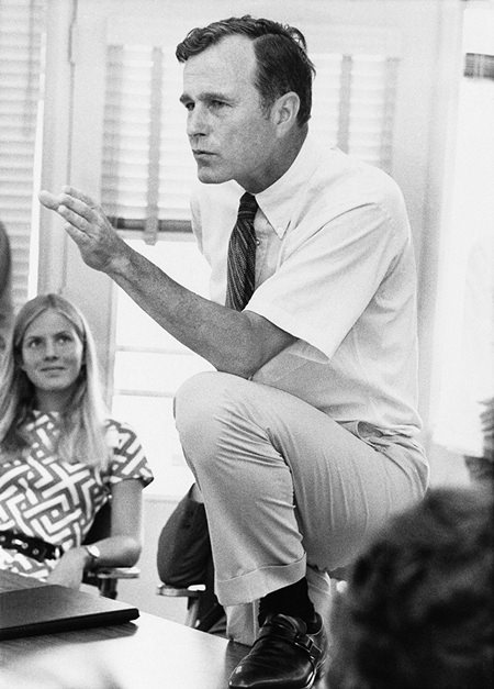 In this Oct. 9, 1970 file photo, Rep. George H.W. Bush, R-Texas, talks with a group of young people at a rally in Houston, Texas. (AP Photo/File)