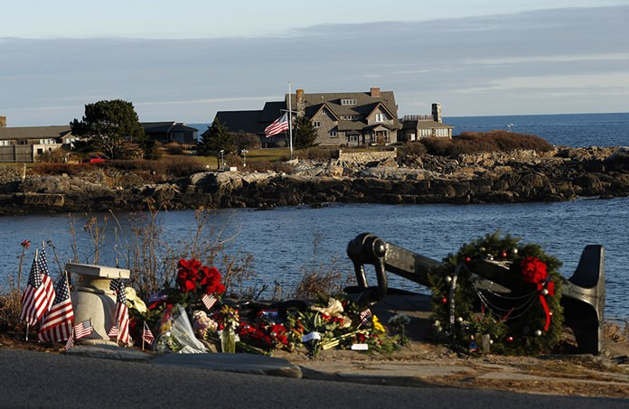 A makeshift memorial for President George H. W. Bush lay across from Walker's Point, the Bush's summer home, Saturday, Dec. 1, 2018, in Kennebunkport, Maine. (AP Photo/Robert F. Bukaty)