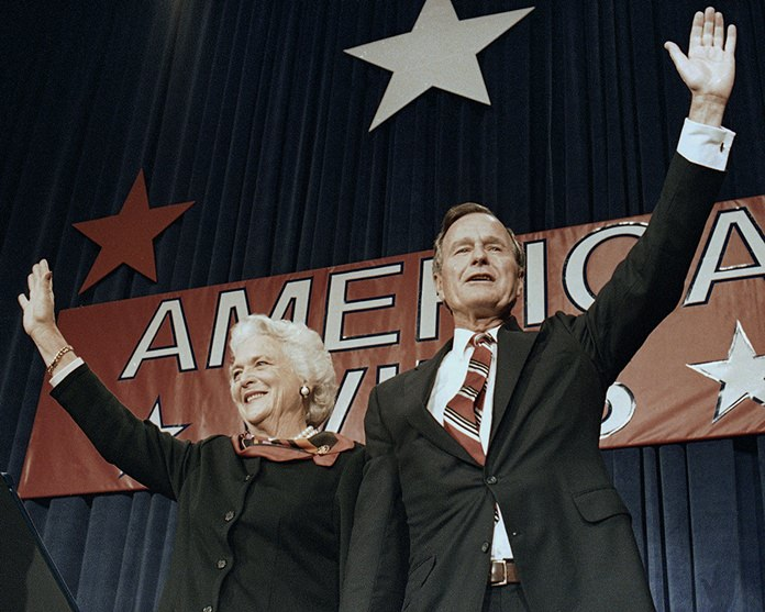 In this Nov. 8, 1988 file photo, President-elect George H.W. Bush and his wife Barbara wave to supporters in Houston, Texas after winning the presidential election. (AP Photo/Scott Applewhite, File)