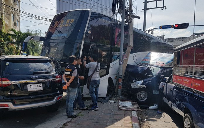 Eight people were hurt when a runaway tour bus slammed into six vehicles stopped at a South Pattaya intersection.