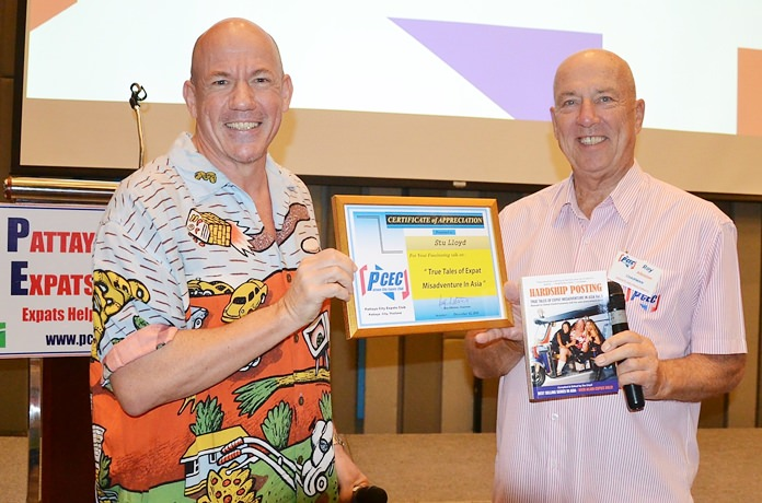 "MC Roy Albiston presents Stu Lloyd with the PCEC's Certificate of Appreciation for his presentation and humor on his book series ""Hardship Posting""."
