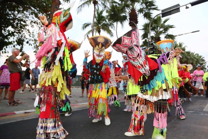 Phi Ta Khon (ghost) dancers provided a lively atmosphere during the parade.