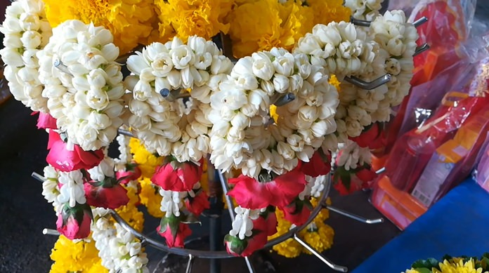 Despite an outpouring of emotions, flower garland sales actually fell this year, due largely to prices being 200 percent higher than normal.